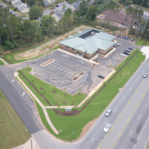 Aerial view of plasma center in nice neighborhood.
